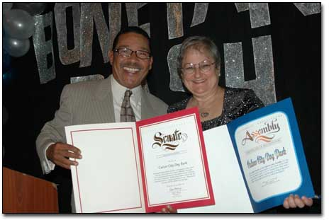 Speaker of the Assembly Emeritus Herb Wesson presenting a Certificate of Appreciation from the Assembly and from State Senator Kevin Murray to Friends of the Culver City Dog Park Chair, Vicki Daly Redholtz at Boneyard Bash 2, October 2004.